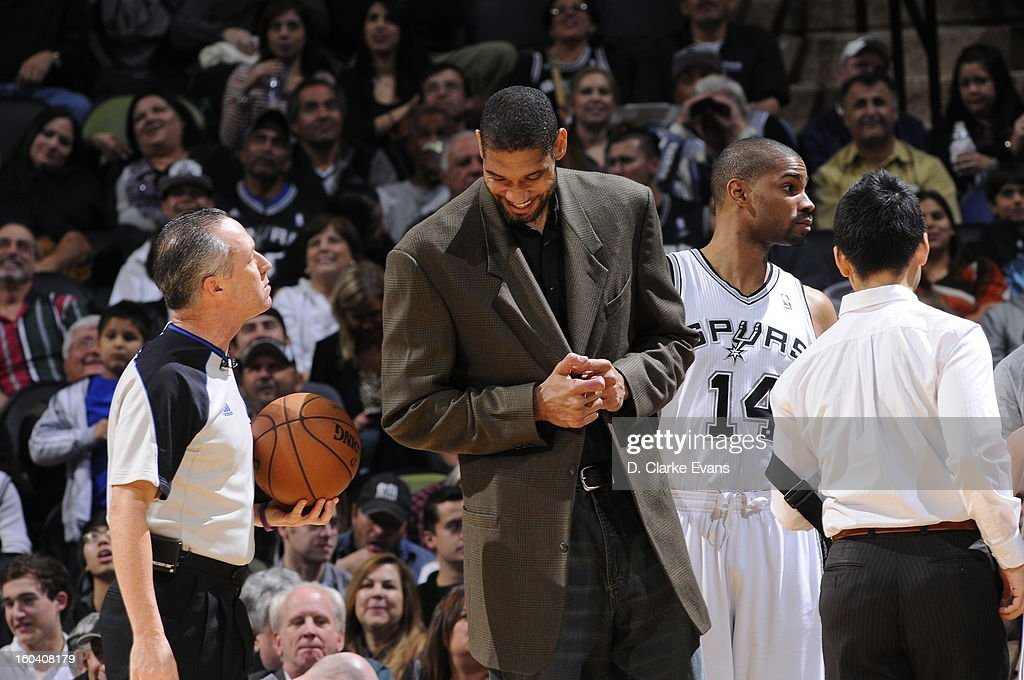 Tim Duncan #21 has a laugh with the referee during the Charlotte Bobcats , San Antonio Spurs game on January 30, 2013 at the AT&T Center in San Antonio, Texas.