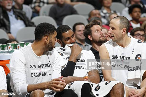 Tim Duncan LaMarcus Aldridge and Manu Ginobili of the San Antonio Spurs during the game against the Houston Rockets on January 2 2016 at ATT Center...