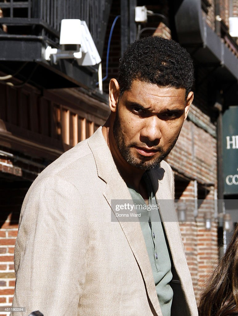 <a gi-track='captionPersonalityLinkClicked' href=/galleries/search?phrase=Tim+Duncan&family=editorial&specificpeople=201467 ng-click='$event.stopPropagation()'>Tim Duncan</a> leaves the 'Late Show with David Letterman' at Ed Sullivan Theater on June 24, 2014 in New York City.