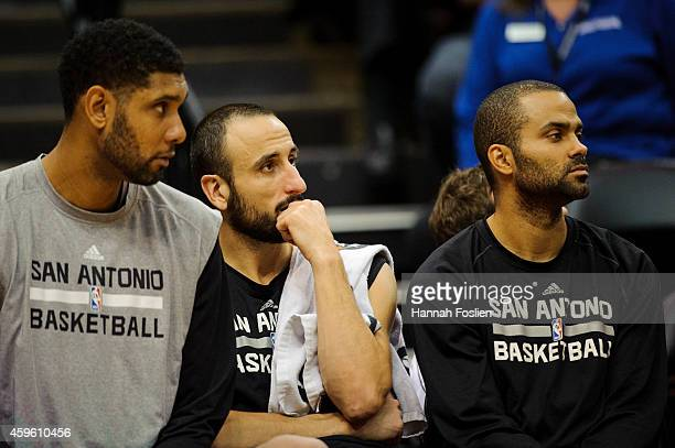 Tim Duncan Manu Ginobili and Tony Parker of the San Antonio Spurs look on during the game against the Minnesota Timberwolves on November 21 2014 at...