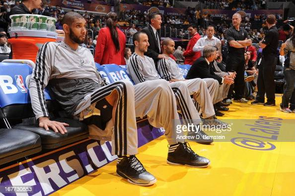 Tim Duncan Manu Ginobili and Tony Parker of the San Antonio Spurs sit on the bench at Staples Center prior to Game Four of the Western Conference...