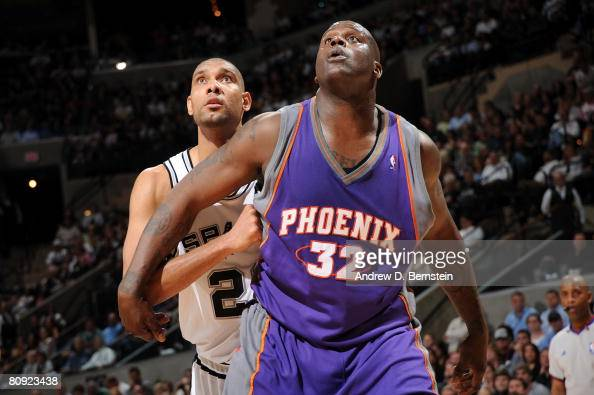 Tim Duncan of the San Antonio Spurs against Shaquille O'Neal of the Phoenix Suns in Game Five of the Western Conference Quarterfinals during the 2008...
