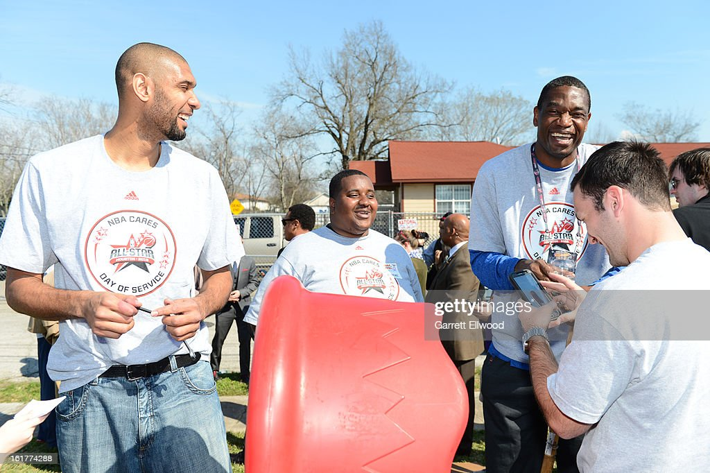 Tim Duncan #21 of the San Antonio Spurs and former NBA player Dikembe Mutombo participate at the 2013 NBA Cares Day of Service at the Playground Build with KaBOOM! on February 15, 2013 in Houston, Texas.