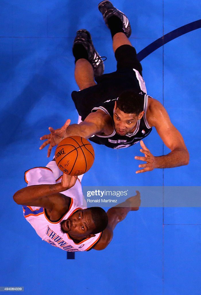 Tim Duncan #21 of the San Antonio Spurs and Kevin Durant #35 of the Oklahoma City Thunder go up for a loose ball in the first half during Game Four of the Western Conference Finals of the 2014 NBA Playoffs at Chesapeake Energy Arena on May 27, 2014 in Oklahoma City, Oklahoma.