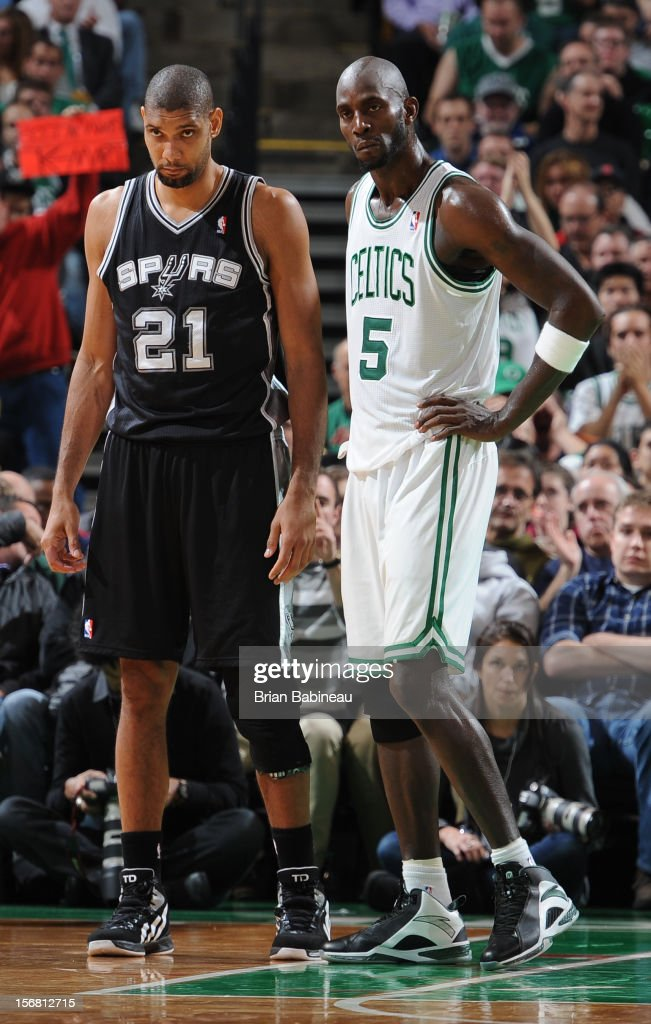 Tim Duncan #21 of the San Antonio Spurs and Kevin Garnett #5 of the Boston Celtics look on during the game on November 21, 2012 at the TD Garden in Boston, Massachusetts.