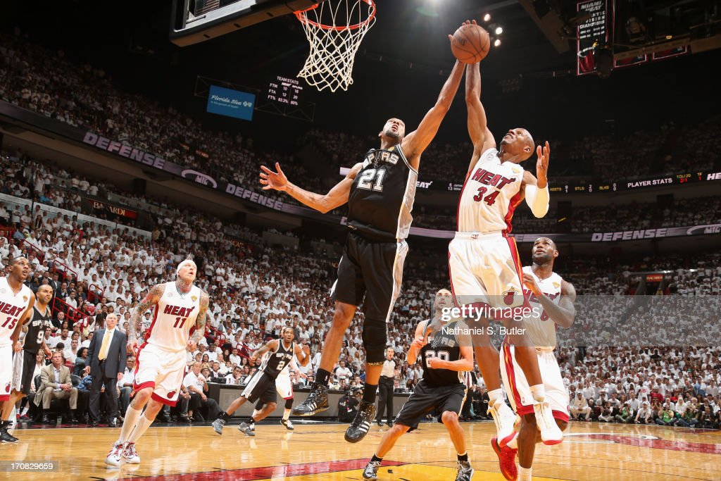 Tim Duncan #21 of the San Antonio Spurs and Ray Allen #34 of the Miami Heat go up for a rebound during Game Six of the 2013 NBA Finals on June 18, 2013 at American Airlines Arena in Miami, Florida.