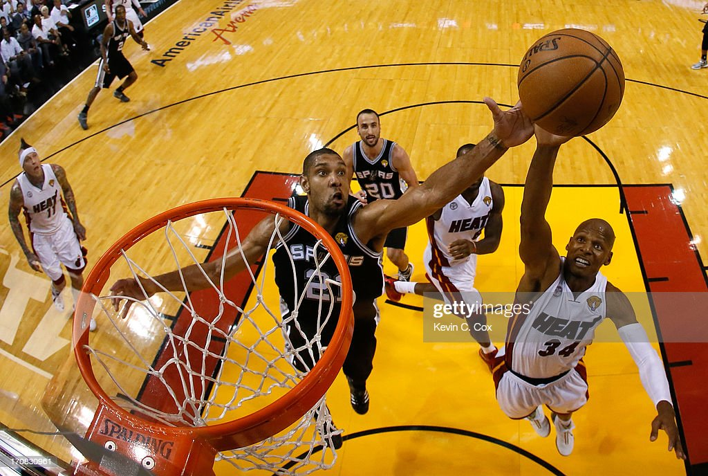 Tim Duncan #21 of the San Antonio Spurs and Ray Allen #34 of the Miami Heat go after a rebound in the fourth quarter during Game Six of the 2013 NBA Finals at AmericanAirlines Arena on June 18, 2013 in Miami, Florida.