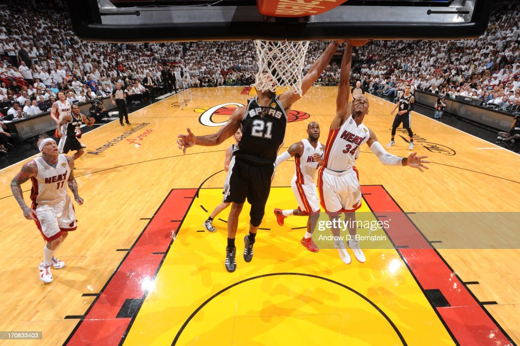 Tim Duncan #21 of the San Antonio Spurs and Ray Allen #34 of the Miami Heat fight for a rebound during Game Six of the 2013 NBA Finals on June 18, 2013 at the American Airlines Arena in Miami, Florida.