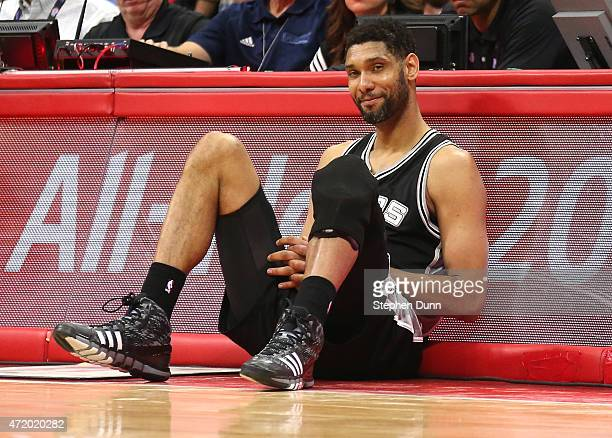 Tim Duncan of the San Antonio Spurs as he sits by the scorer's table waiting to enter the game against the Los Angeles Clippers during Game Seven of...