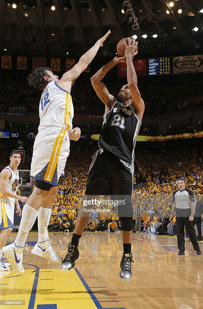 Tim Duncan #21 of the San Antonio Spurs attempts a shot against Andrew Bogut #12 of the Golden State Warriors in Game Four of the Western Conference Semifinals during the 2013 NBA Playoffs on May 12, 2013 at Oracle Arena in Oakland, California.