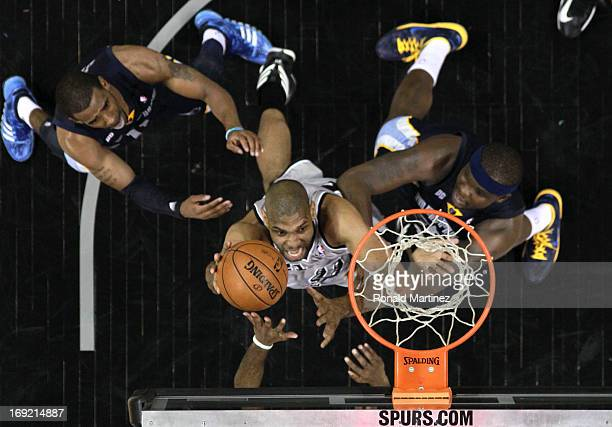 Tim Duncan of the San Antonio Spurs attempts a shot against Mike Conley and Zach Randolph of the Memphis Grizzlies during Game Two of the Western...