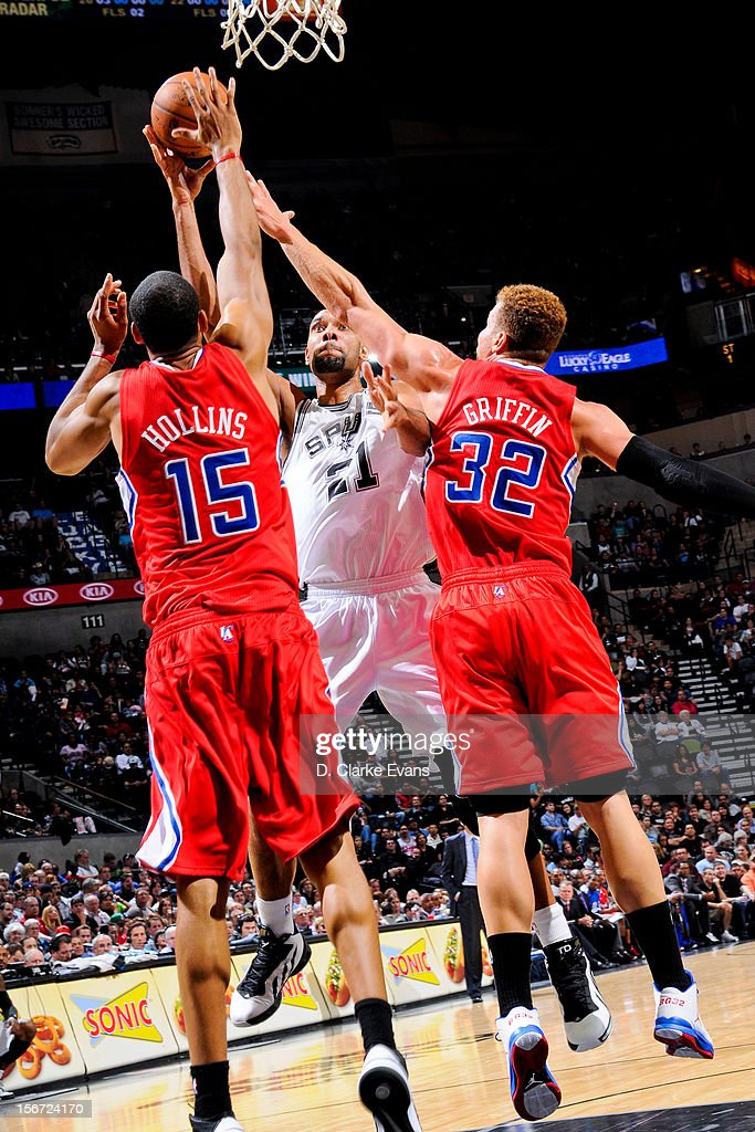 Tim Duncan #21 of the San Antonio Spurs attempts a shot against Ryan Hollins #15 and Blake Griffin #32 of the Los Angeles Clippers on November 19, 2012 at the AT&T Center in San Antonio, Texas.