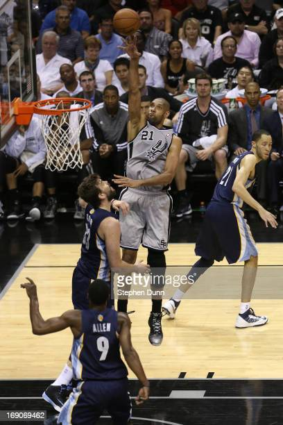 Tim Duncan of the San Antonio Spurs attempts a shot in the first half against Marc Gasol of the Memphis Grizzlies during Game One of the Western...