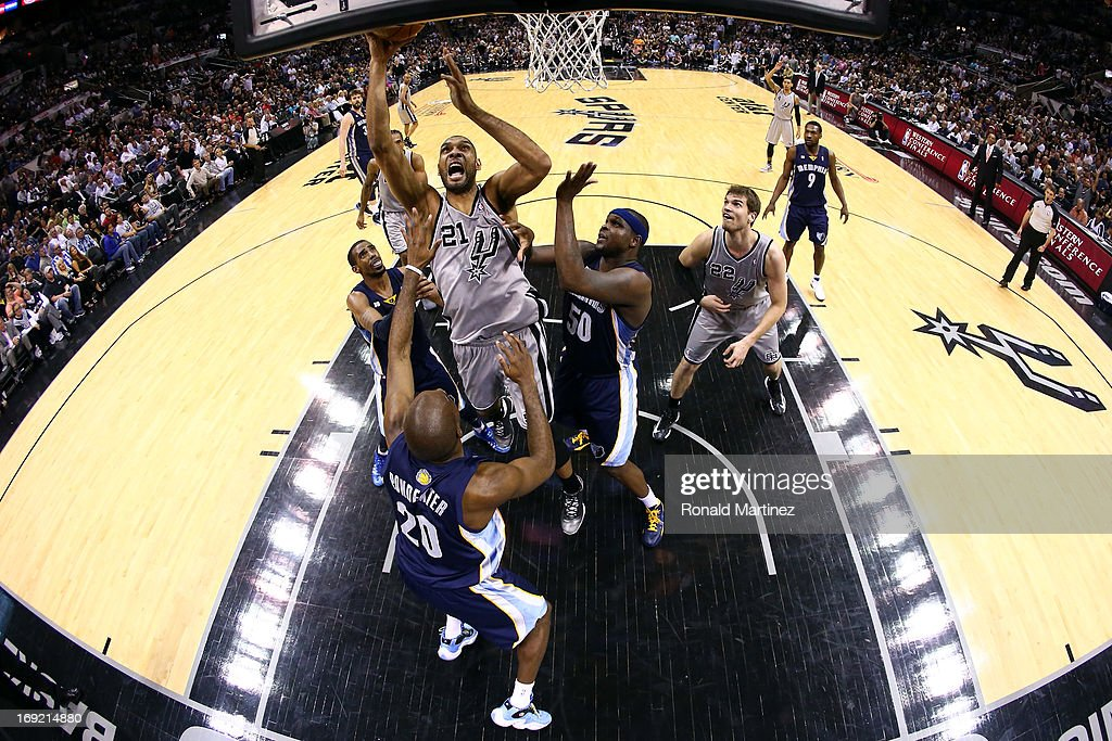 <a gi-track='captionPersonalityLinkClicked' href=/galleries/search?phrase=Tim+Duncan&family=editorial&specificpeople=201467 ng-click='$event.stopPropagation()'>Tim Duncan</a> #21 of the San Antonio Spurs attempts a shot in the second half against <a gi-track='captionPersonalityLinkClicked' href=/galleries/search?phrase=Quincy+Pondexter&family=editorial&specificpeople=4176540 ng-click='$event.stopPropagation()'>Quincy Pondexter</a> #20 and <a gi-track='captionPersonalityLinkClicked' href=/galleries/search?phrase=Zach+Randolph&family=editorial&specificpeople=201595 ng-click='$event.stopPropagation()'>Zach Randolph</a> #50 of the Memphis Grizzlies during Game Two of the Western Conference Finals of the 2013 NBA Playoffs at AT&T Center on May 21, 2013 in San Antonio, Texas.