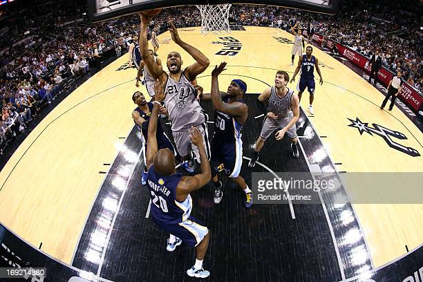 Tim Duncan of the San Antonio Spurs attempts a shot in the second half against Quincy Pondexter and Zach Randolph of the Memphis Grizzlies during...