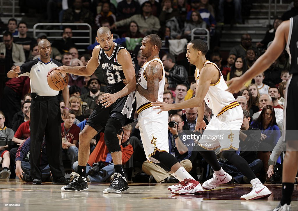 Tim Duncan #21 of the San Antonio Spurs backs in towards the basket against Marreese Speights #15 and Shaun Livingston #14 of the Cleveland Cavaliers at The Quicken Loans Arena on February 13, 2013 in Cleveland, Ohio.