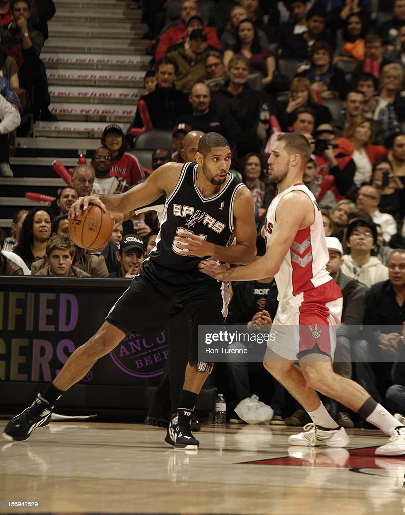 <a gi-track='captionPersonalityLinkClicked' href=/galleries/search?phrase=Tim+Duncan&family=editorial&specificpeople=201467 ng-click='$event.stopPropagation()'>Tim Duncan</a> #21 of the San Antonio Spurs backs up to the basket vs the Toronto during the game on November 25, 2012 at the Air Canada Centre in Toronto, Ontario, Canada.
