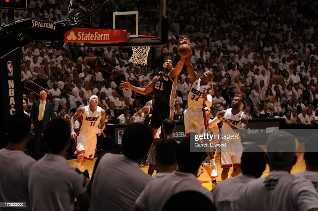 Tim Duncan #21 of the San Antonio Spurs battles for a rebound against Ray Allen #34 of the Miami Heat during Game Six of the 2013 NBA Finals on June 18, 2013 at American Airlines Arena in Miami, Florida.