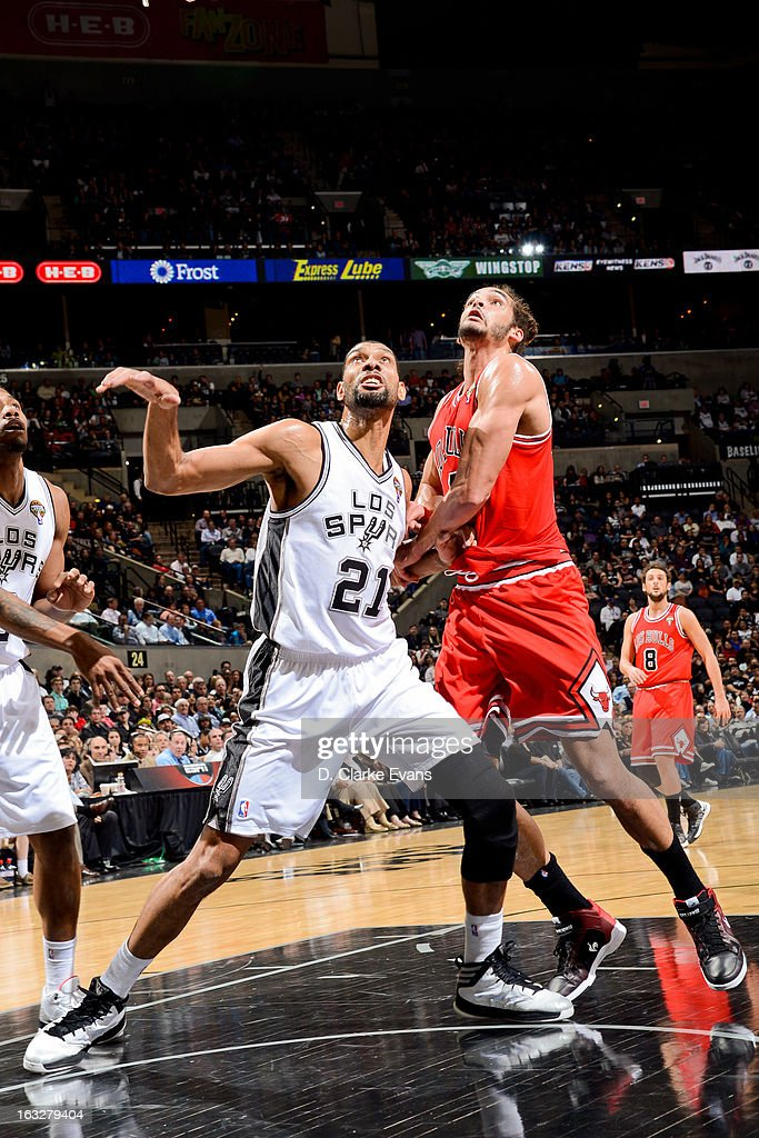 Tim Duncan #21 of the San Antonio Spurs battles for rebound position against Joakim Noah #13 of the Chicago Bulls on March 6, 2013 at the AT&T Center in San Antonio, Texas.