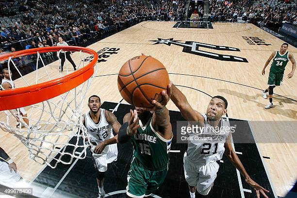 Tim Duncan of the San Antonio Spurs blocks the shot of Greg Monroe of the Milwaukee Bucks on December 2 2015 at the ATT Center in San Antonio Texas...