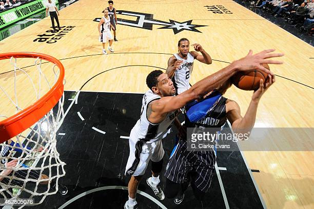 Tim Duncan of the San Antonio Spurs blocks the shot of Tobias Harris of the Orlando Magic during the game at the ATT Center on February 4 2015 in San...