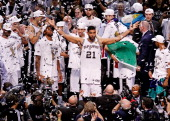Tim Duncan of the San Antonio Spurs celebrates after defeating the Miami Heat in Game Five of the 2014 NBA Finals at the ATT Center on June 15 2014...