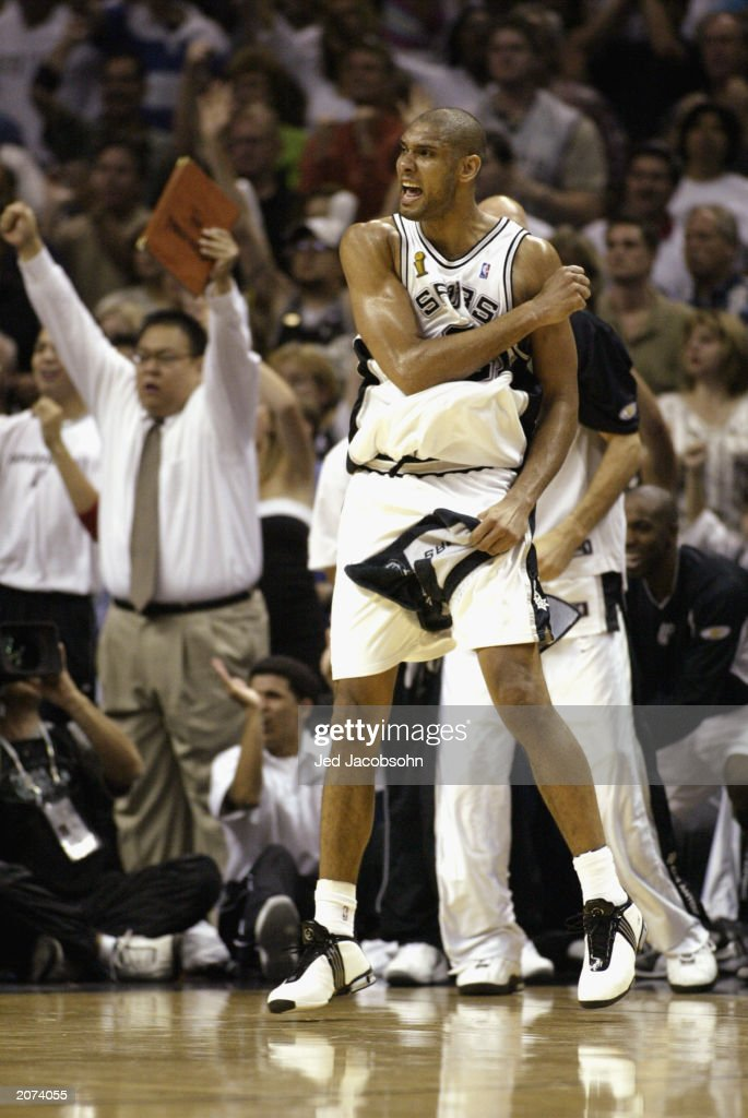 Tim Duncan of the San Antonio Spurs celebrates in Game two of the 2003 NBA Finals against the New Jersey Nets at SBC Center on June 6 2003 in San...