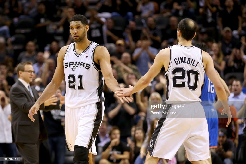 Tim Duncan #21 of the San Antonio Spurs celebrates with Manu Ginobili #20 in the first half against the Oklahoma City Thunder in Game Two of the Western Conference Finals during the 2014 NBA Playoffs at AT&T Center on May 21, 2014 in San Antonio, Texas.