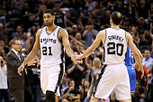 Tim Duncan of the San Antonio Spurs celebrates with Manu Ginobili in the first half against the Oklahoma City Thunder in Game Two of the Western...