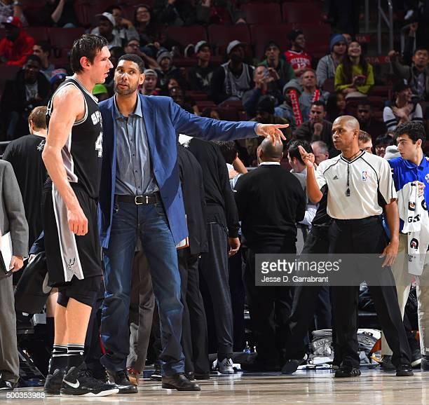 Tim Duncan of the San Antonio Spurs coaches Boban Marjanovic against the Philadelphia 76ers at Wells Fargo Center on December 7 2015 in Philadelphia...