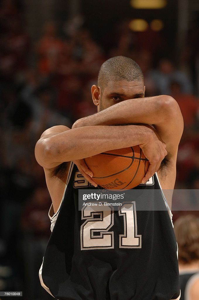 <a gi-track='captionPersonalityLinkClicked' href=/galleries/search?phrase=Tim+Duncan&family=editorial&specificpeople=201467 ng-click='$event.stopPropagation()'>Tim Duncan</a> #21 of the San Antonio Spurs collects his thoughts against the Cleveland Cavaliers in Game Four of the NBA Finals at the Quicken Loans Arena on June 14, 2007 in Cleveland, Ohio.