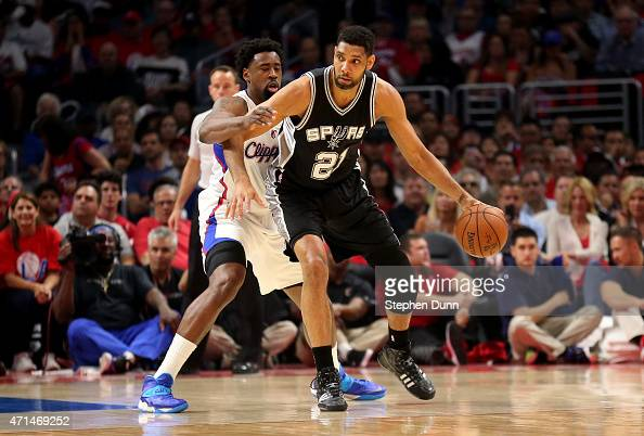Tim Duncan of the San Antonio Spurs controls the ball against DeAndre Jordan of the Los Angeles Clippers during Game Five of the Western Conference...