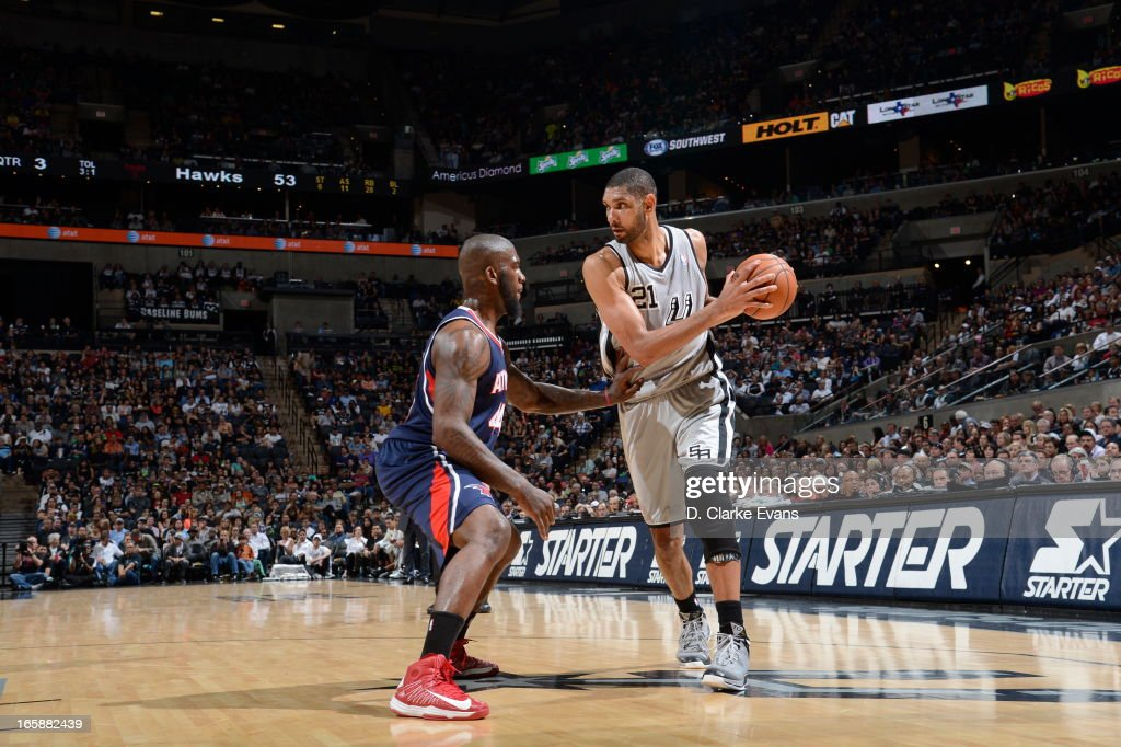 Tim Duncan of the San Antonio Spurs controls the ball against Ivan Johnson of the Atlanta Hawks on April 6 2013 at the ATT Center in San Antonio...