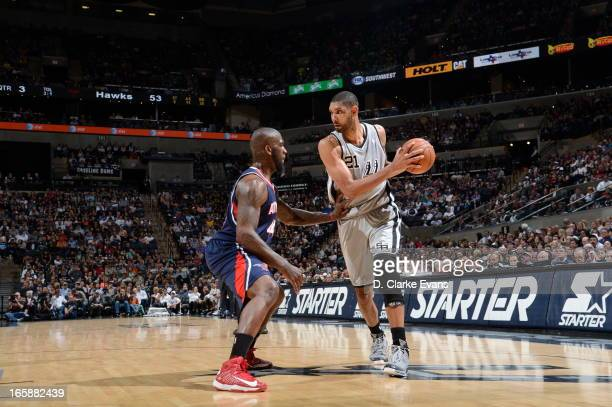 Tim Duncan of the San Antonio Spurs controls the ball against Ivan Johnson of the Atlanta Hawks on April 6 2013 at the ATT Center in San Antonio...