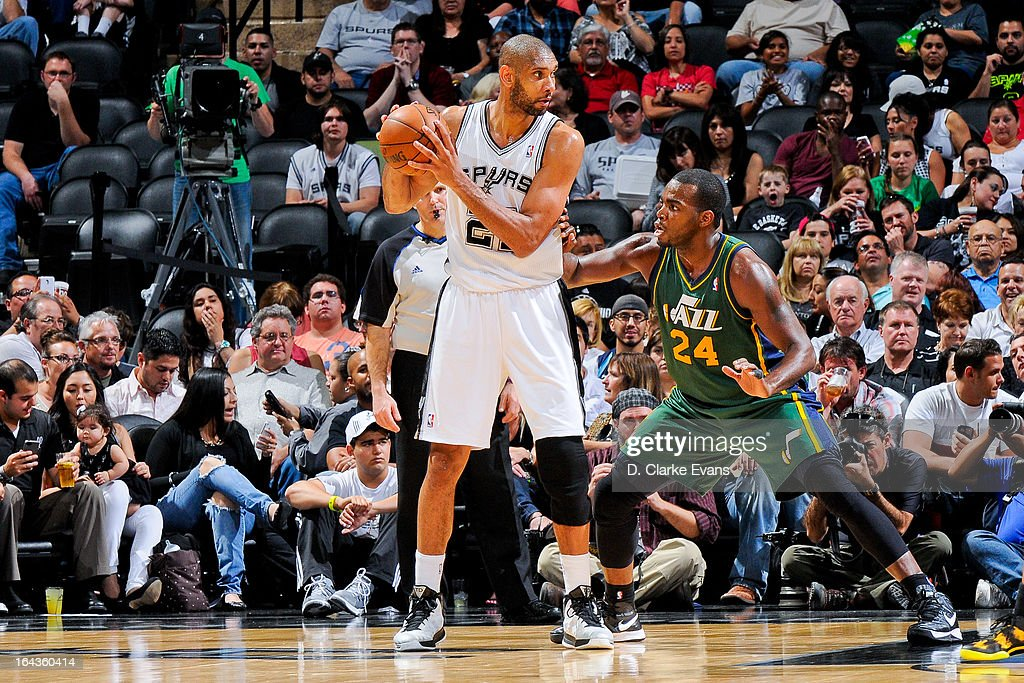 Tim Duncan #21 of the San Antonio Spurs controls the ball against Paul Millsap #24 of the Utah Jazz on March 22, 2013 at the AT&T Center in San Antonio, Texas.