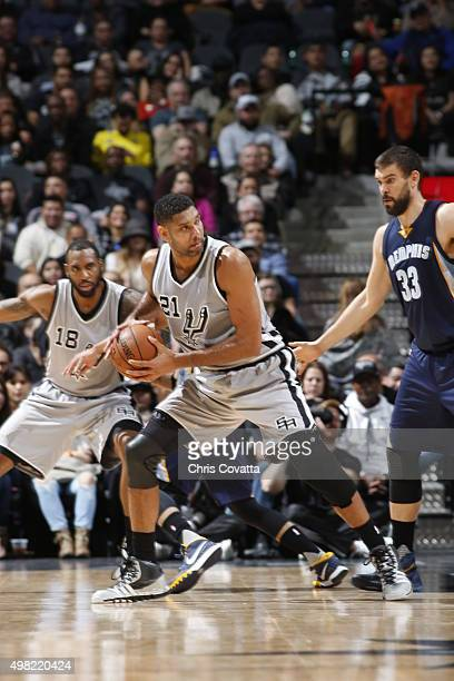 Tim Duncan of the San Antonio Spurs defends the ball against the Memphis Grizzlies during the game on November 21 2015 at ATT Center in San Antonio...