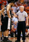 Tim Duncan of the San Antonio Spurs discusses a call with referee Joe Crawford in the second half against the Phoenix Suns in Game one of the Western...