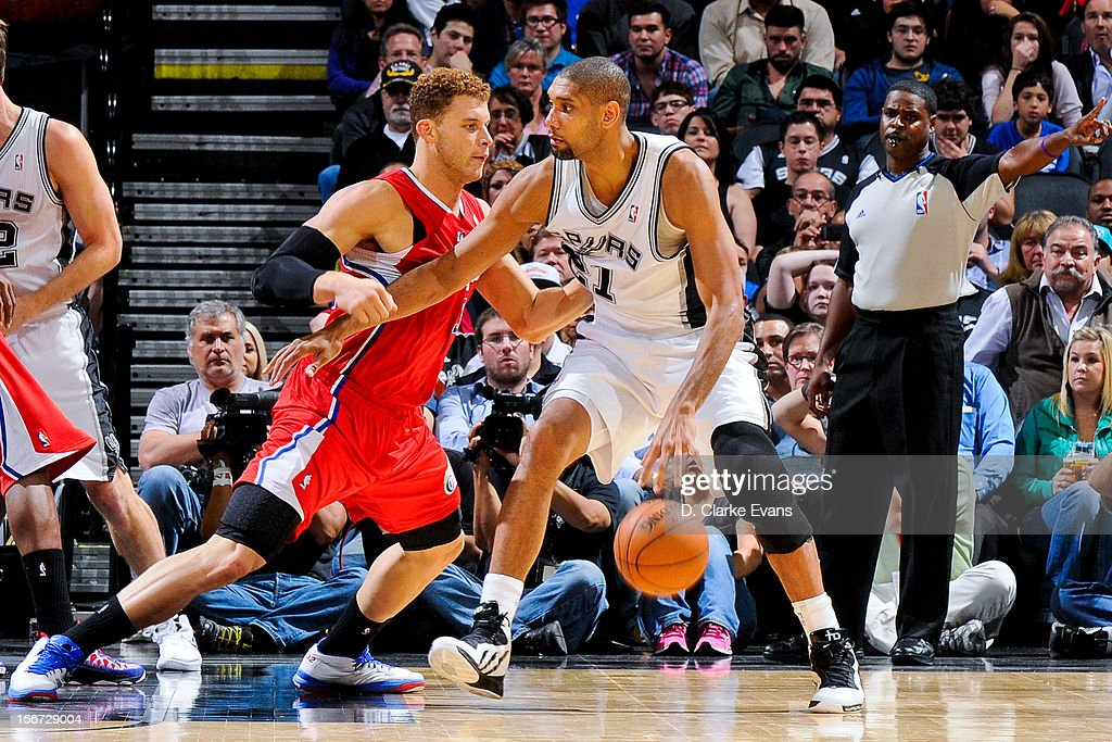 Tim Duncan #21 of the San Antonio Spurs drives against Blake Griffin #32 of the Los Angeles Clippers on November 19, 2012 at the AT&T Center in San Antonio, Texas.