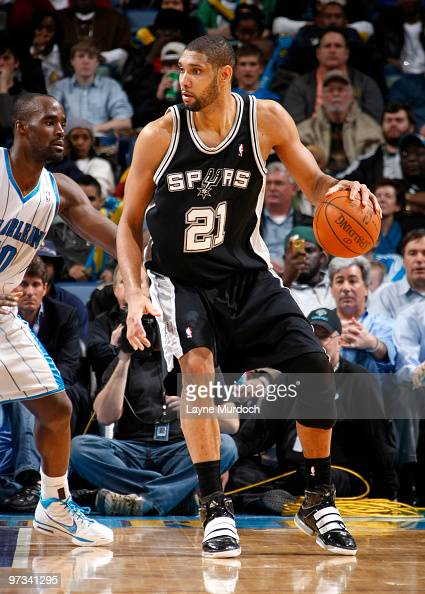 Tim Duncan of the San Antonio Spurs drives against Emeka Okafor of the New Orleans Hornets on March 1 2010 at the New Orleans Arena in New Orleans...