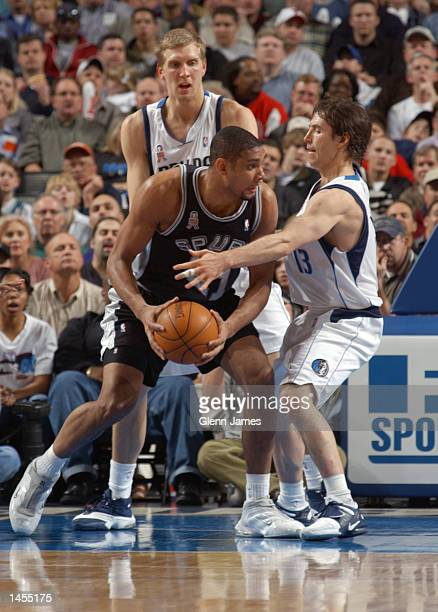 Tim Duncan of the San Antonio Spurs drives against Steve Nash of the Dallas Mavericks at the American Airlines Center in Dallas Texas DIGITAL IMAGE...