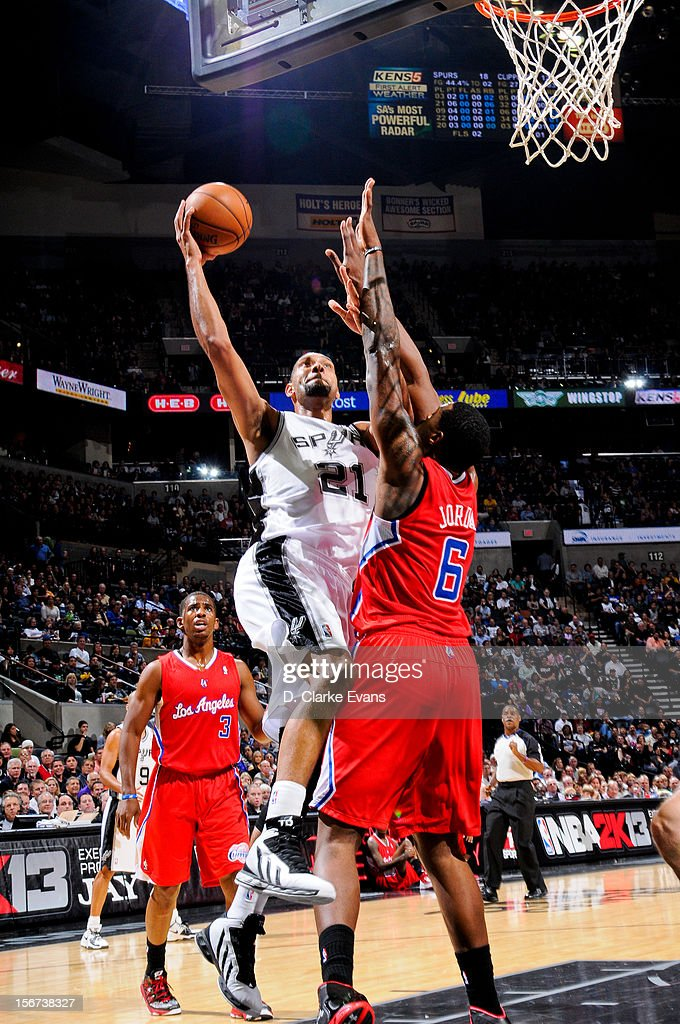 Tim Duncan #21 of the San Antonio Spurs drives to the basket against DeAndre Jordan #6 of the Los Angeles Clippers on November 19, 2012 at the AT&T Center in San Antonio, Texas.