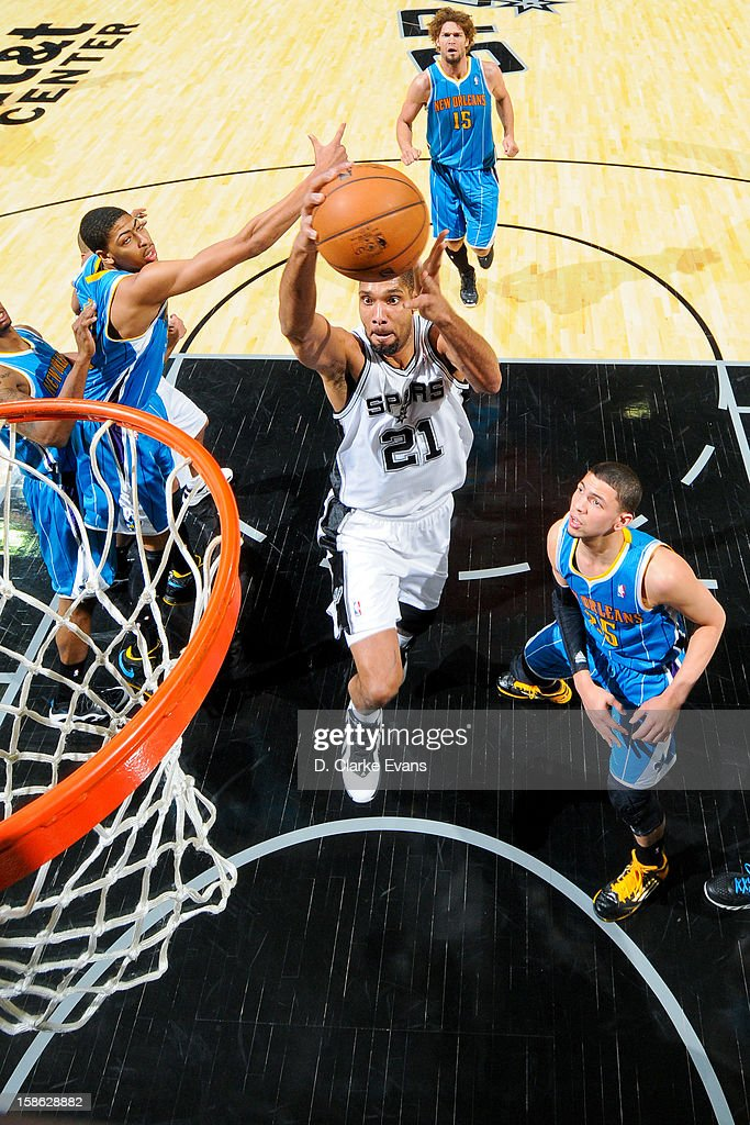 <a gi-track='captionPersonalityLinkClicked' href=/galleries/search?phrase=Tim+Duncan&family=editorial&specificpeople=201467 ng-click='$event.stopPropagation()'>Tim Duncan</a> #21 of the San Antonio Spurs drives to the basket against Anthony Davis #23 of the New Orleans Hornets on December 21, 2012 at the AT&T Center in San Antonio, Texas.