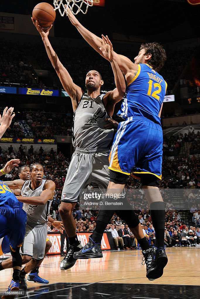 <a gi-track='captionPersonalityLinkClicked' href=/galleries/search?phrase=Tim+Duncan&family=editorial&specificpeople=201467 ng-click='$event.stopPropagation()'>Tim Duncan</a> #21 of the San Antonio Spurs drives to the basket against <a gi-track='captionPersonalityLinkClicked' href=/galleries/search?phrase=Andrew+Bogut&family=editorial&specificpeople=207105 ng-click='$event.stopPropagation()'>Andrew Bogut</a> #12 of the Golden State Warriors in Game Two of the Western Conference Semifinals during the 2013 NBA Playoffs on May 8, 2013 at the AT&T Center in San Antonio, Texas.