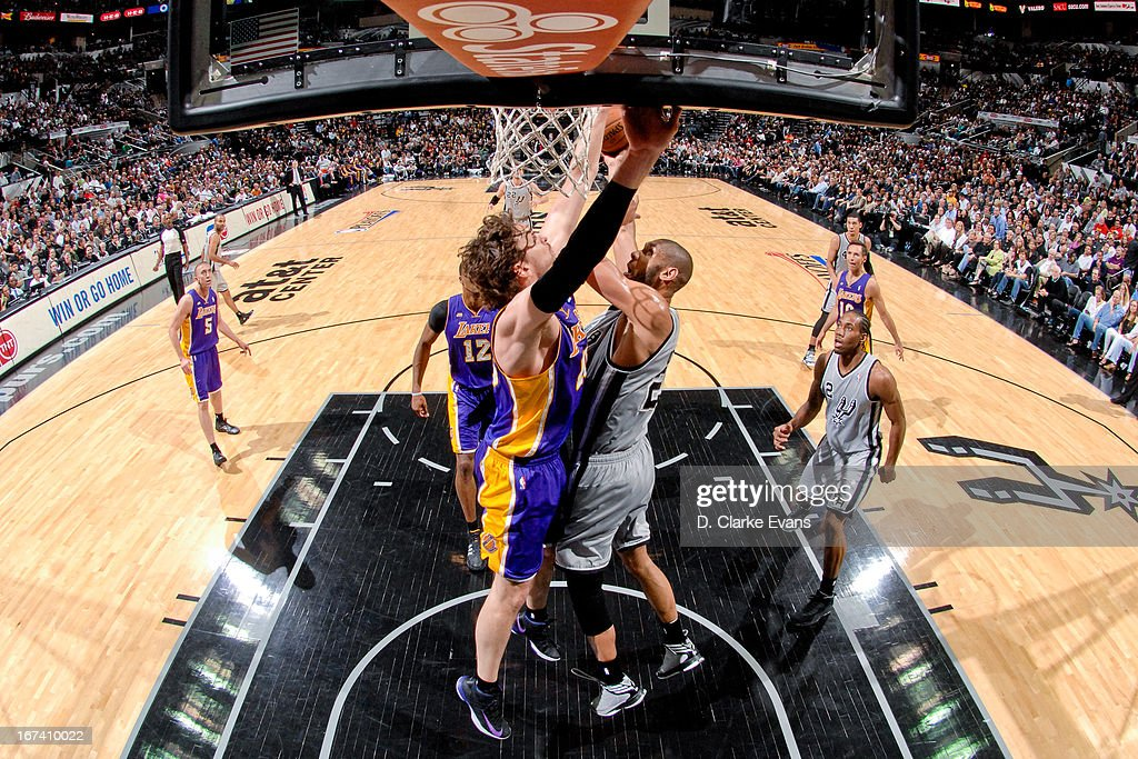 <a gi-track='captionPersonalityLinkClicked' href=/galleries/search?phrase=Tim+Duncan&family=editorial&specificpeople=201467 ng-click='$event.stopPropagation()'>Tim Duncan</a> #21 of the San Antonio Spurs drives to the basket against <a gi-track='captionPersonalityLinkClicked' href=/galleries/search?phrase=Pau+Gasol&family=editorial&specificpeople=201587 ng-click='$event.stopPropagation()'>Pau Gasol</a> #16 of the Los Angeles Lakers in Game Two of the Western Conference Quarterfinals during the 2013 NBA Playoffs on April 24, 2013 at the AT&T Center in San Antonio, Texas.