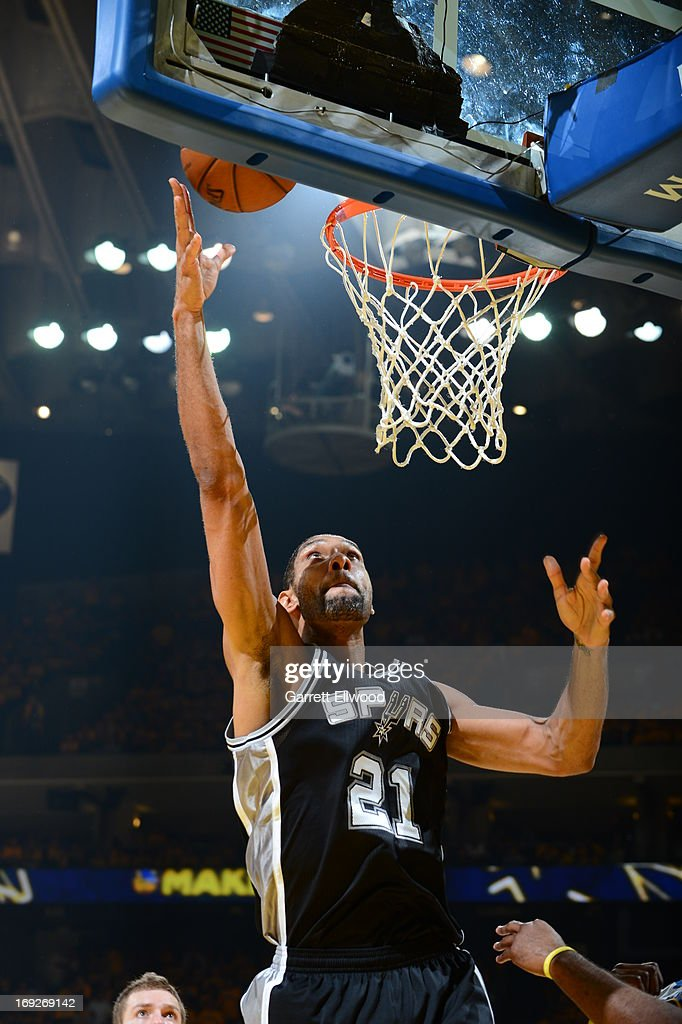 <a gi-track='captionPersonalityLinkClicked' href=/galleries/search?phrase=Tim+Duncan&family=editorial&specificpeople=201467 ng-click='$event.stopPropagation()'>Tim Duncan</a> #21 of the San Antonio Spurs drives to the basket against the Golden State Warriors in Game Three of the Western Conference Semifinals during the 2013 NBA Playoffs on May 10, 2013 at the Oracle Arena in Oakland, California.