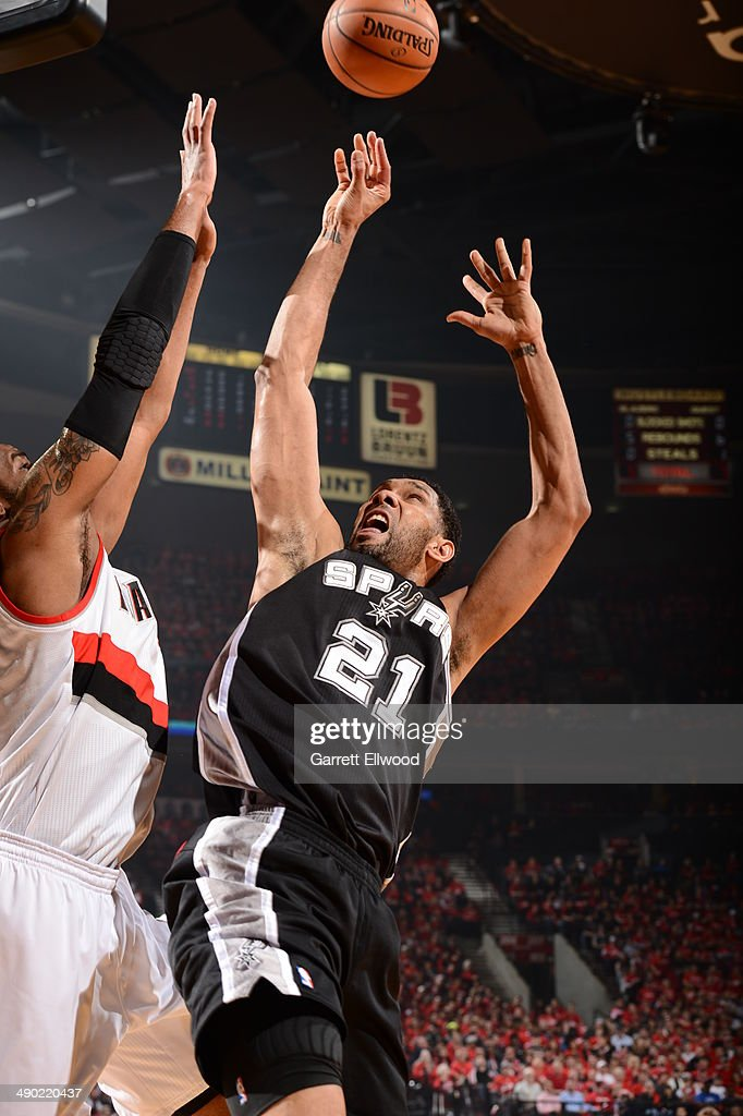 <a gi-track='captionPersonalityLinkClicked' href=/galleries/search?phrase=Tim+Duncan&family=editorial&specificpeople=201467 ng-click='$event.stopPropagation()'>Tim Duncan</a> #21 of the San Antonio Spurs drives to the basket against the Portland Trail Blazers in Game Three of the Western Conference Semifinals on May 10, 2014 at the Moda Center in Portland, Oregon.