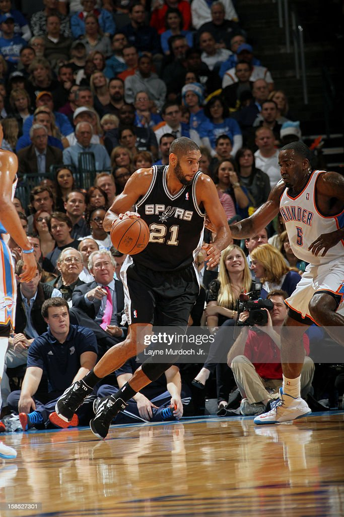 <a gi-track='captionPersonalityLinkClicked' href=/galleries/search?phrase=Tim+Duncan&family=editorial&specificpeople=201467 ng-click='$event.stopPropagation()'>Tim Duncan</a> #21 of the San Antonio Spurs drives to the hole against the Oklahoma City Thunder during an NBA game on December 17, 2012 at the Chesapeake Energy Arena in Oklahoma City, Oklahoma.