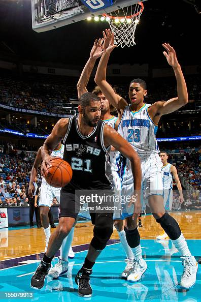 Tim Duncan of the San Antonio Spurs drives under the basket against Anthony Davis of the New Orleans Hornets on October 31 2012 at the New Orleans...