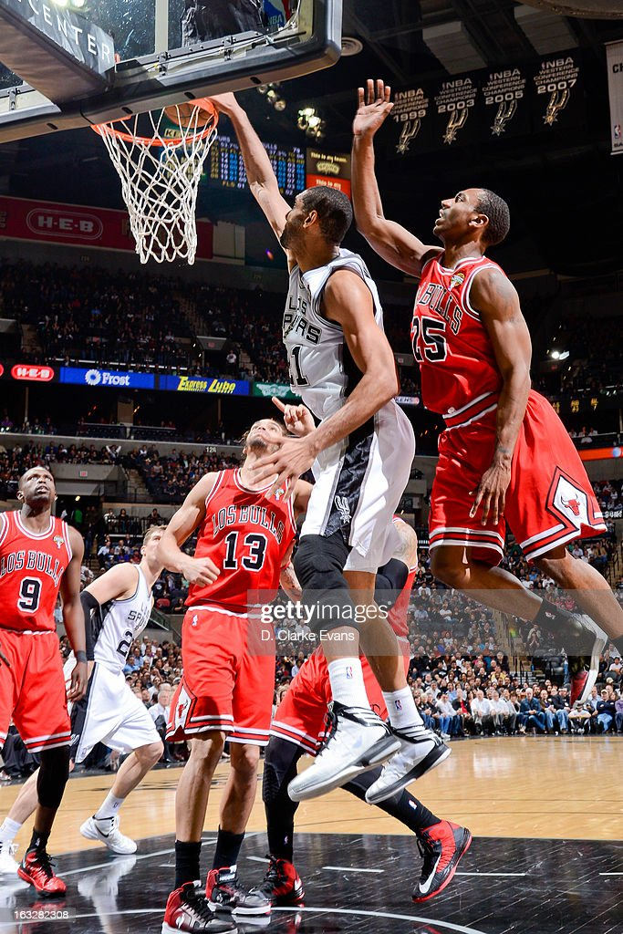 <a gi-track='captionPersonalityLinkClicked' href=/galleries/search?phrase=Tim+Duncan&family=editorial&specificpeople=201467 ng-click='$event.stopPropagation()'>Tim Duncan</a> #21 of the San Antonio Spurs dunks against <a gi-track='captionPersonalityLinkClicked' href=/galleries/search?phrase=Marquis+Teague&family=editorial&specificpeople=7621183 ng-click='$event.stopPropagation()'>Marquis Teague</a> #25 of the Chicago Bulls on March 6, 2013 at the AT&T Center in San Antonio, Texas.
