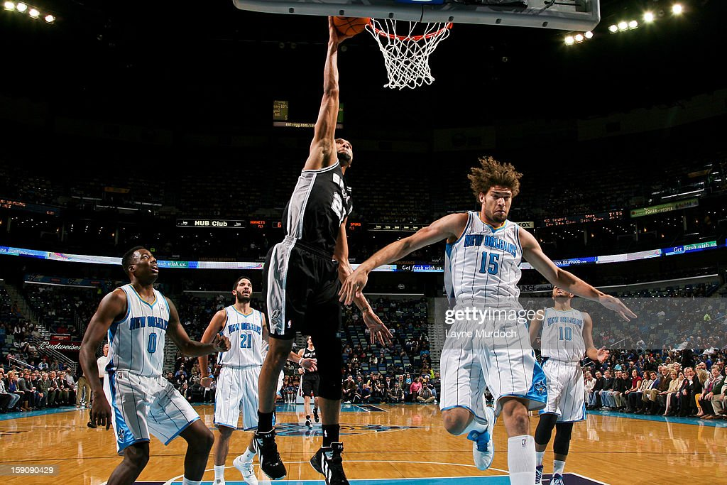 Tim Duncan #21 of the San Antonio Spurs dunks against Robin Lopez #15 of the New Orleans Hornets on January 7, 2013 at the New Orleans Arena in New Orleans, Louisiana.